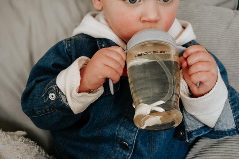 The perfect cup when your baby is learning to drink by himself? Sippy cup! It has a soft spout and perfect handles.