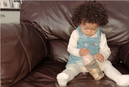 Our lovely Raeni find the right dental care sippy cup and enjoy it.